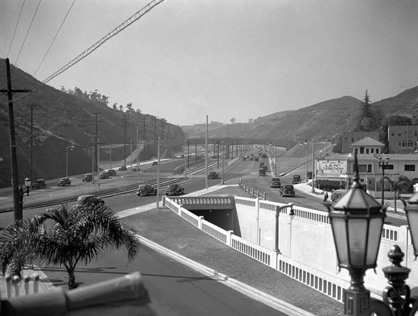 The tunnel in the right foreground is an example of the grade-separation used in the Cahuenga Pass Freeway. Since closed, it once extended Highland Blvd. to the north, under the freeway. Courtesy of the Automobile Club of Southern California Archives.
