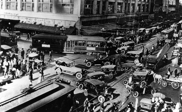 Streetcars, automobiles, horse-drawn carriages, and pedestrians clog the intersection of Broadway and 7th, circa 1920. Courtesy of the Los Angeles Public Library Photograph Collection.