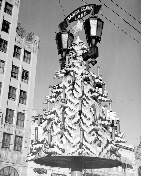 Light standards became Christmas trees on Santa Claus Lane, as show in this circa 1938 photo. Courtesy of the Dick Whittington Photography Collection, USC Libraries.