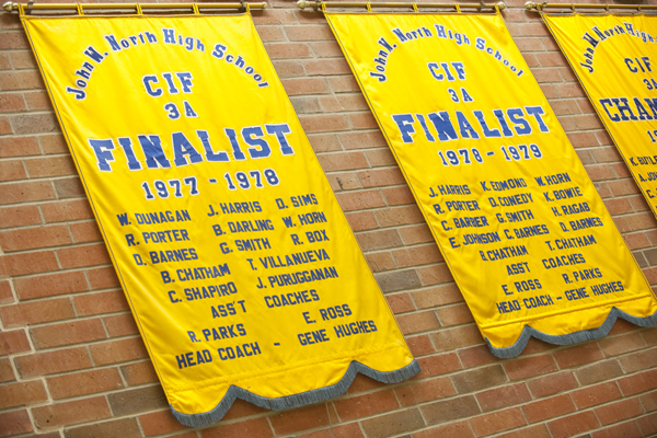 CIF banners - D Sims, T Chatham and their teammates on the wall | Photograph by Douglas McCulloh