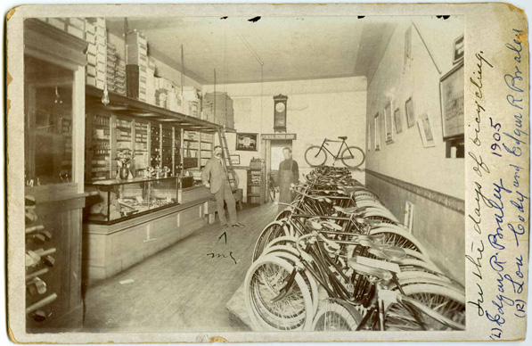 "Handwritten caption: ""In the days of bicycling"". Ed Braley's Bike Emporium located at 33 South Raymond Ave., Pasadena, circa 1905. Courtesy of the Archives, Pasadena Museum of History (C15-6f)"