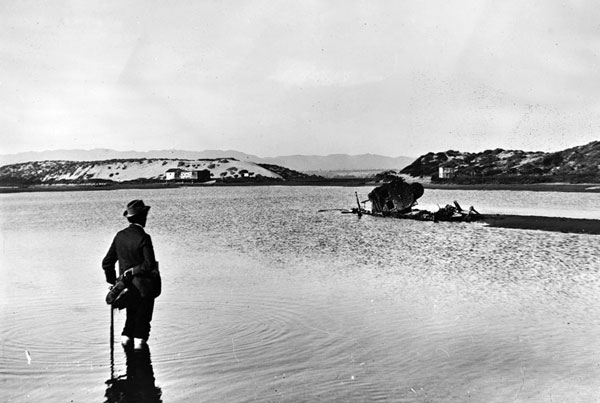A man wades into Ballona Lagoon, circa 1902. Courtesy of the Title Insurance and Trust / C.C. Pierce Photography Collection, USC Libraries.
