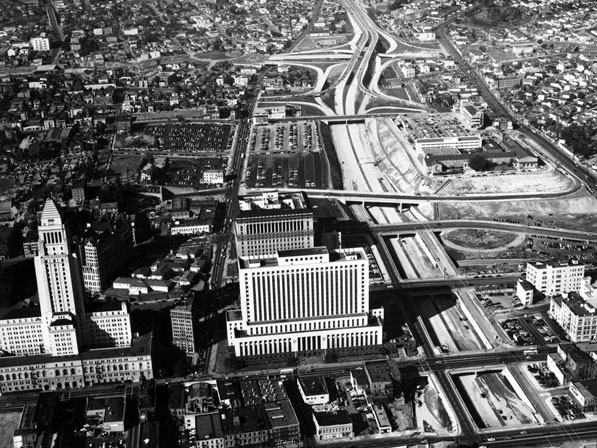 101 freeway under construction near downtown Los Angeles and City Hall, 1953. Southeast of the Four Level (101-110) Interchange, the 101 freeway is named the Santa Ana Freeway.