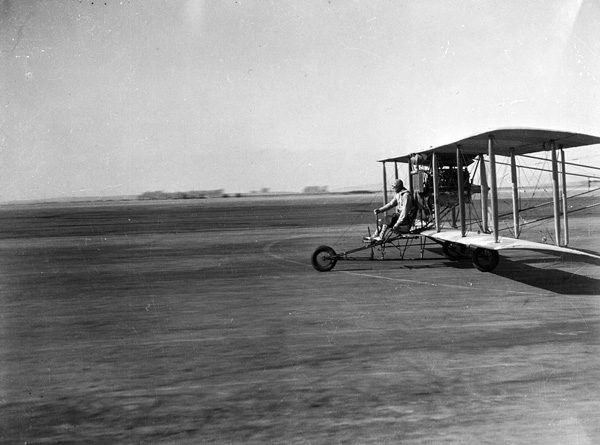 A biplane, possibly participating in an air show, on the Mines Field runway circa 1931. Courtesy of the Los Angeles Area Chamber of Commerce Collection, USC Libraries.