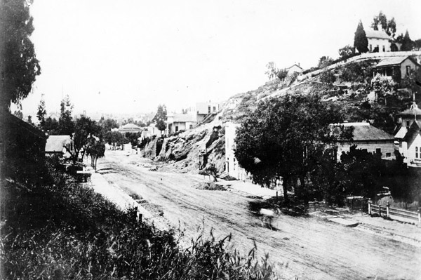 Circa 1880 view of Hill Street near Second or Third. Modest buildings stand atop Bunker Hill on the right. Courtesy of the California Historical Society Collection, USC Libraries.