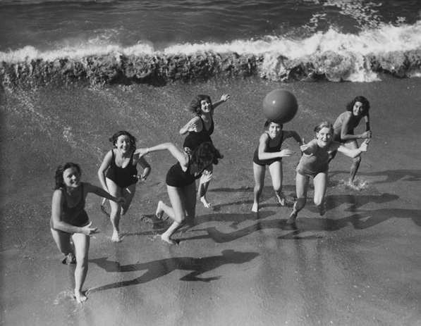 Women chase a ball on a Los Angeles-area beach, circa 1930. From the Los Angeles Area Chamber of Commerce Collection.