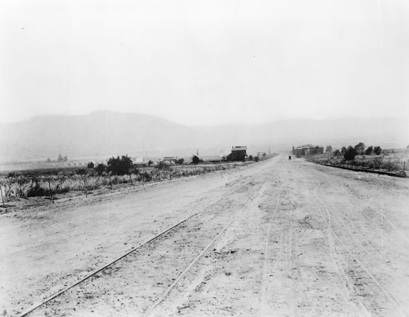 View southeast down Olive Avenue, circa 1887, showing the fledgling town of Burbank in the distance. Streetcar tracks run down the middle of the road. Courtesy of the Title Insurance and Trust / C.C. Pierce Photography Collection, USC Libraries.