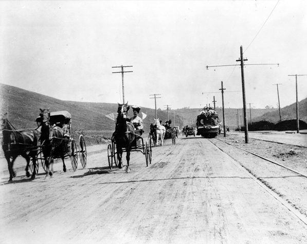Motorcars and horse-drawn carriages racing alongside the Los Angeles Pacific's streetcars to celebrate the opening of the Hill Street tunnels in 1909. Courtesy of the Title Insurance and Trust / C.C. Pierce Photography Collection, USC Libraries.