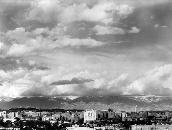 Before Los Angeles repealed its building height limit in 1956, flatness prevailed in the city's skyline. Circa 1940 photograph courtesy of the Dick Whittington Photography Collection, USC Libraries.