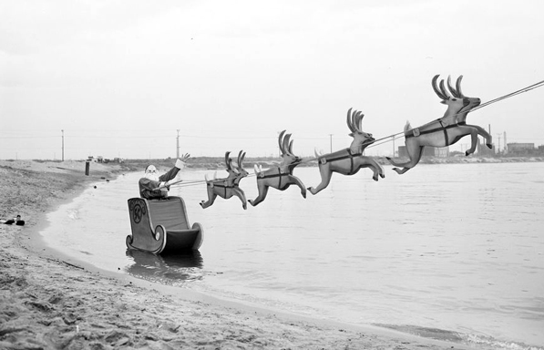 Santa Claus participates in a stunt at a speed boat rodeo at L.A.'s Cabrillo Beach on Christmas Eve, 1955. Courtesy of the Los Angeles Examiner Collection, USC Libraries.