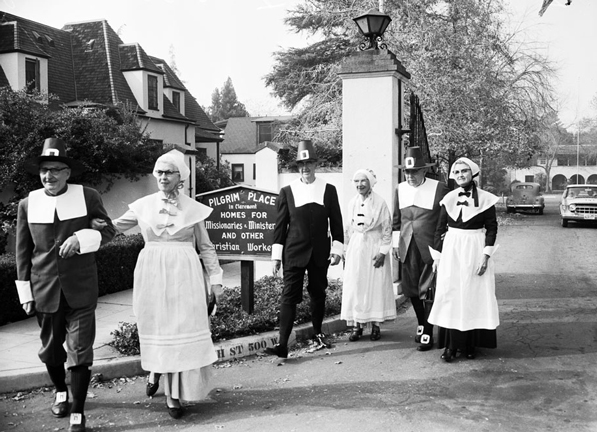 Thankgiving Day celebrants leave Claremont's Pilgrim Place missionary home dressed as Plymouth colonists. Courtesy of the Los Angeles Examiner Collection, USC Libraries.
