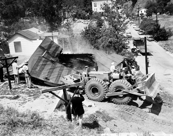 A bulldozer demolishes a Chavez Ravine home on May 9, 1959. Courtesy of the Los Angeles Examiner Collection, USC Libraries.
