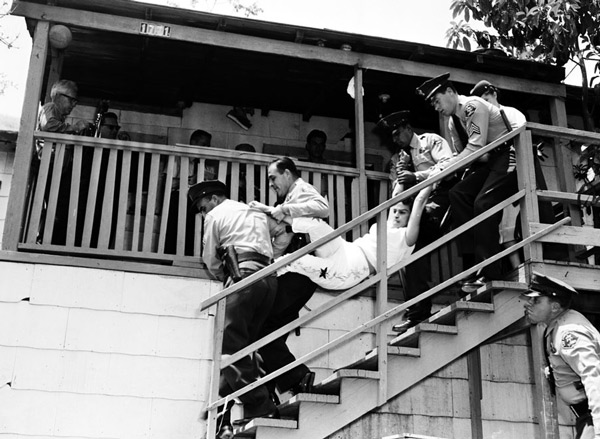Police carry Aurora Vargas, daughter of Manuel and Abrana Arechiga, from her Chavez Ravine home on May 9, 1959. Courtesy of the Los Angeles Examiner Collection, USC Libraries.