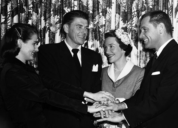 Reagan marrying Nancy Davis in 1951. Actor William Holden, his best man, appears on the right. Courtesy of the Los Angeles Examiner Collection, USC Libraries.