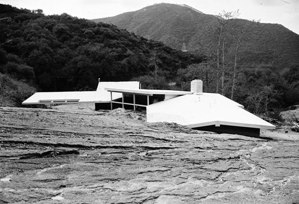 A La Canada Flintridge house partially buried by a debris flow, 1952. Courtesy of the Los Angeles Examiner Collection, USC Libraries.