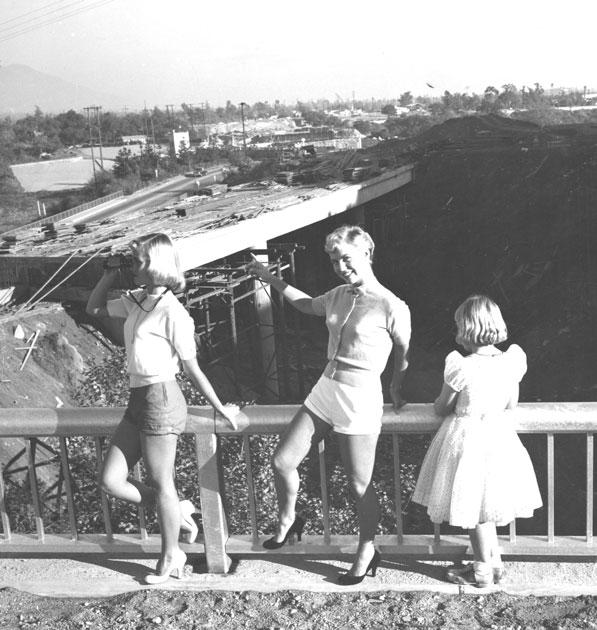 A woman poses in front of the unfinished Foothill Freeway. Courtesy of the Glendale Public Library.