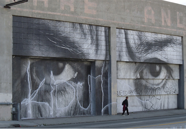 A wheatpaste by French artist J.R. on the side of the Geffen Contemporary at MOCA was defaced by tagging.