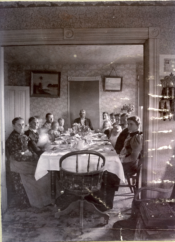 The family of the Reverend F. R. Holcomb enjoys a Thanksgiving dinner in 1898. Courtesy of the Reverend F. R. Holcomb Photograph Collection. P146.1