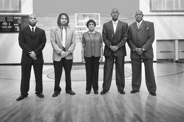 Assistant Coaches Joshua Thomas, Anthony Tyson, Alicestyne Tyson Smith, Coach John Smith, Assistant Coach Joseph Huff at center court.   Photo: Douglas McCulloh