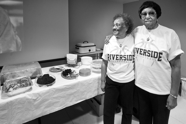 Roberta McClinton and Alicestyne Smith -- sisters with championship necklaces and their homemade buffet. | Photo: Douglas McCulloh