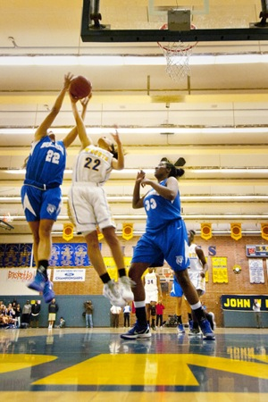 Simone DeCoud reaching for the rebound over 'the bigs' | Photograph by Douglas McCulloh