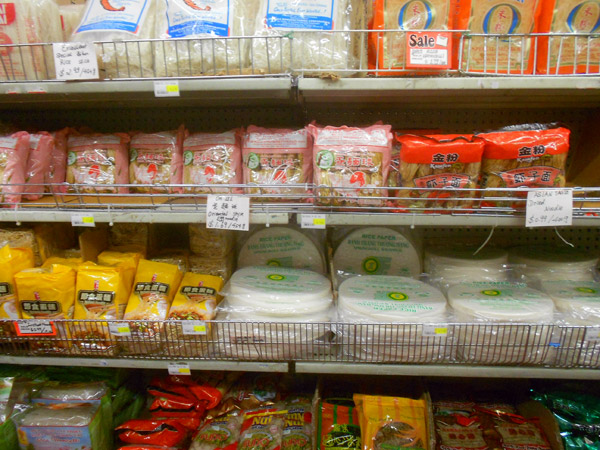 Noodles of various shapes, sizes, ingredients and countries of origin fill an aisle at A-Grocery Warehouse in Echo Park.