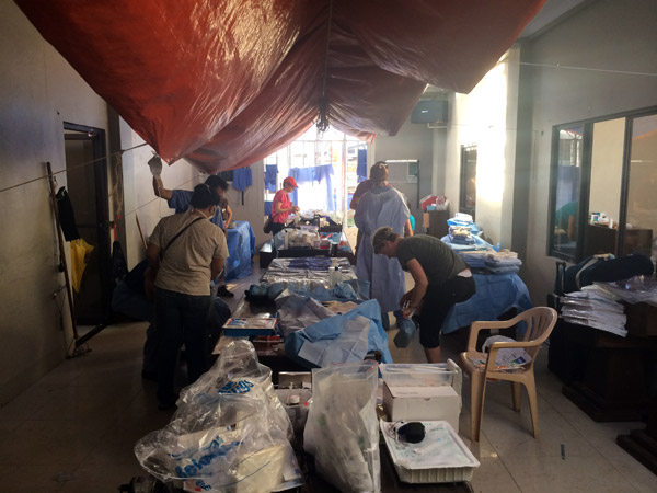 Doctors from Mammoth Medical Missions set up a makeshift surgical ward in the town hall of Tanauan, Leyte, Philippines, to treat the sick and injured survivors of Typhoon Haiyan.