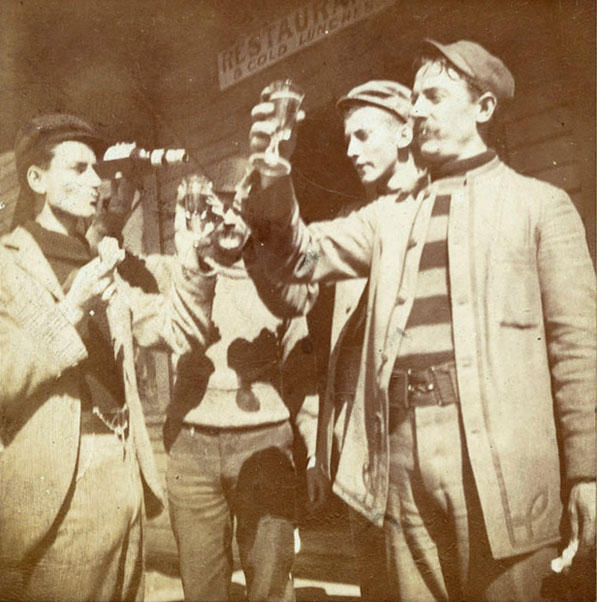 Men lift their glasses of beer in a toast, circa 1920s. Courtesy of the California Historical Society Collection, USC Libraries.