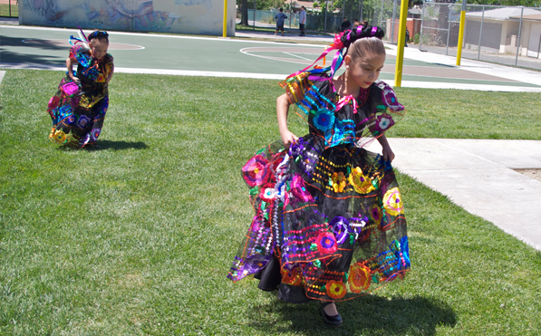 Dancers rush to make a costume change.