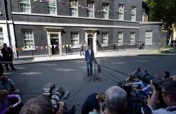 U.S. Republican presidential candidate Mitt Romney speaks to reporters outside 10 Downing Street after meeting with British Prime Minister David Cameron in central London today. | Photo: CARL COURT/AFP/GettyImages