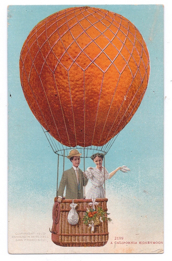 A postcard from the early 20th century showing a honeymooning couple enjoying a balloon ride, carried aloft by an oversized California orange. From the David Boulé Collection.