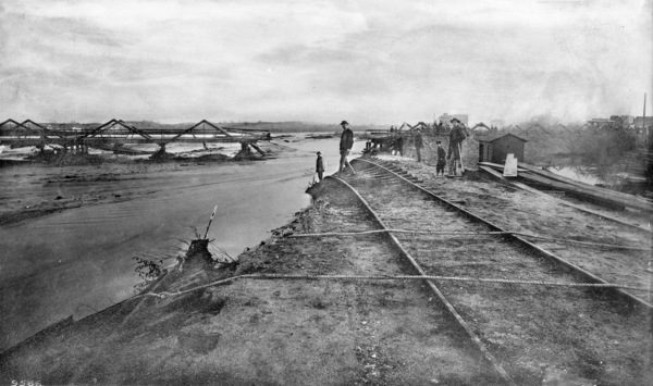 A swollen Los Angeles River destroyed Los Angeles' Downey Avenue bridge in 1886. Courtesy of the USC Libraries - California Historical Society Collection.