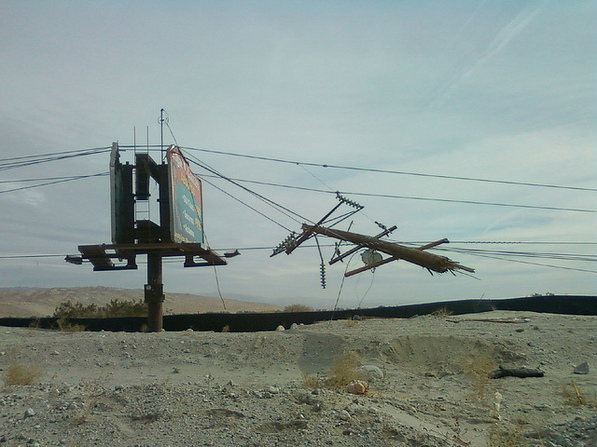 Broken off by Saturday's high winds, a power pole rests precariously on nearby lines. | Creative Commons photo by Florian Boyd