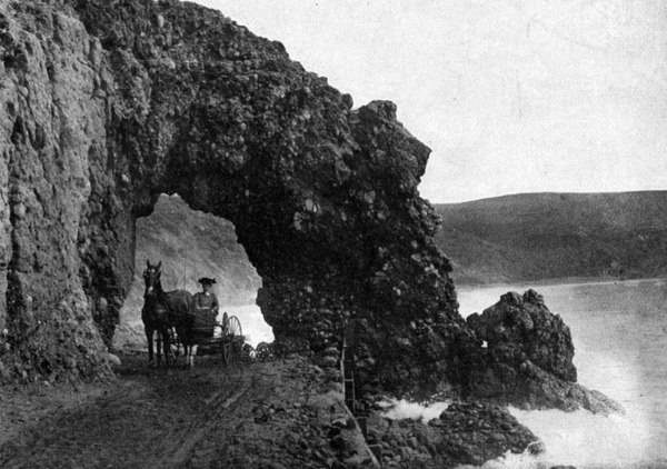 The wagon road that eventually became PCH once passed through a natural formation named Arch Rock. Courtesy of the Photo Collection - Los Angeles Public Library.