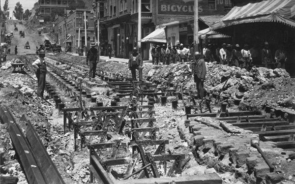 Workers dig up abandoned cable car railway tracks on Second Street. Courtesy of the Metro Transportation Library and Archive.