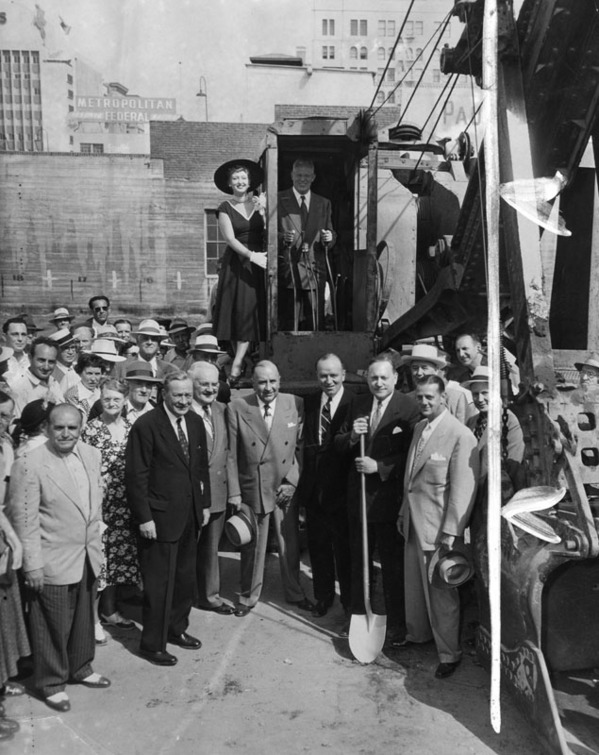 Assembled dignitaries, including Governor Earl Warren (at the controls of the shovel) at the groundbreaking ceremony for the Hotel Statler in 1950. Courtesy of the Herald-Examiner Collection, Los Angeles Public Library.