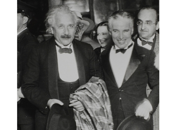Physicist Albert Einstein and filmmaker Charlie Chaplin at the Hollywood Bowl premiere of 'City Lights,' 1931. Courtesy of the Watson Family Photographic Archive.