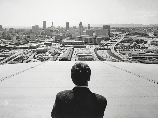 Delmar Watson (back to camera) looks out over downtown Los Angeles. Courtesy of the Watson Family Photographic Archive.