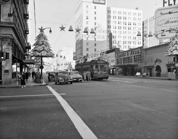 Hollywood and Vine is decorated for the holidays in this ca.1953 photo, which looks west down Hollywood Blvd. from Vine St. Courtesy of the Metro Transportation Library and Archive.