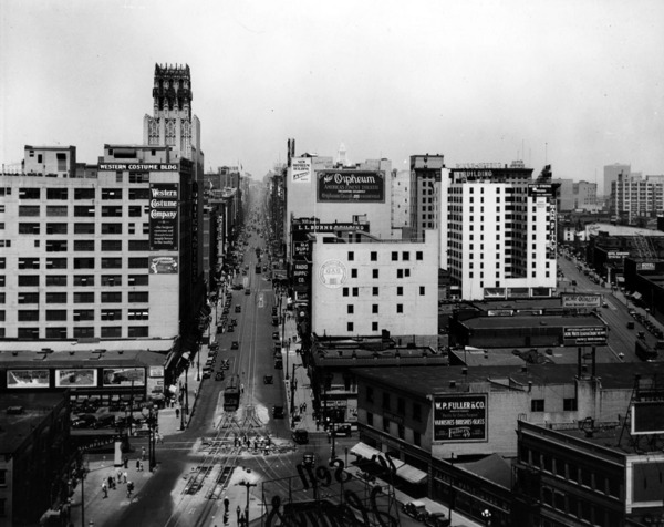 A view looking north up Broadway, showing the fork created by Broadway's 1919 and 1893 extensions at the bottom of the photo. Courtesy of the USC Libraries - Dick Whittington Photography Collection.