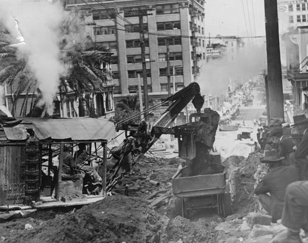 Before razing the entire hill became a possibility, the city first bored tunnels through Bunker Hill. Here, a steam shovel digs the Second Street Tunnel circa 1921. Courtesy of the Photo Collection - Los Angeles Public Library.