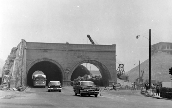 Road cuts and hill regrading transformed several of downtown Los Angeles' tunnels, like the Hill Street Tunnels, shown here at 1st Street in 1955, into mere arches. Courtesy of the Photo Collection - Los Angeles Public Library.