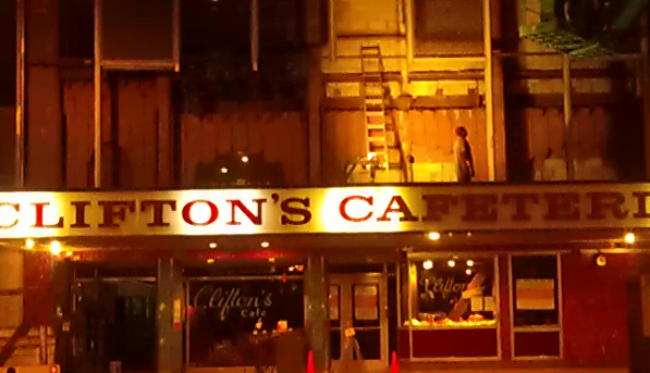 Workers remove Clifton's circa-1960s aluminum facade. Photo: Kim Cooper, Esotouric.