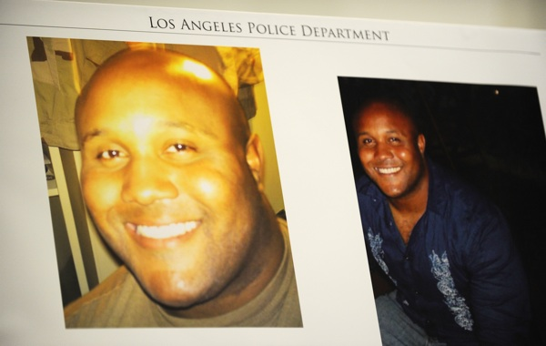 Photos of fired Los Angeles Police Department officer Christopher Dorner are seen at a press conference regarding the manhunt for Dorner. Photo: Robyn Beck/AFP/Getty Images)
