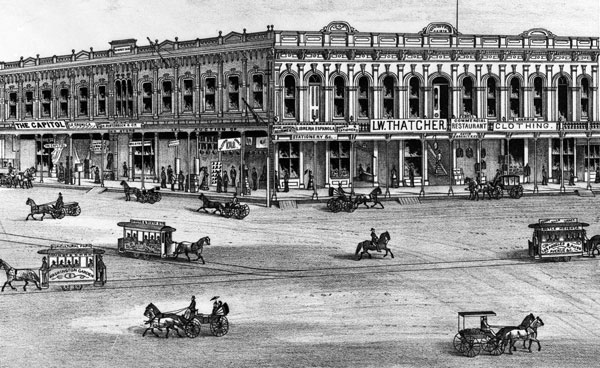 In this circa 1880 lithograph, streetcars from three competing railways cross in front of the Downey Block. Courtesy of the Title Insurance and Trust, and C.C. Pierce Photography Collection, USC Libraries.