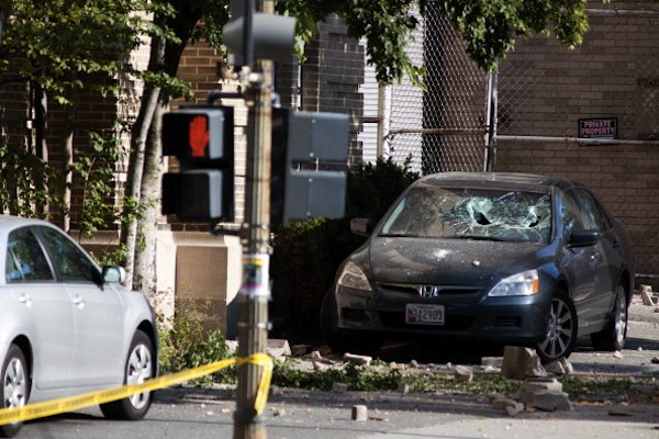 A car parked in front of the Embassy of Ecuador in Washington D.C. suffered damaged from falling bricks during a 5.8 earthquake that struck the Eastern United States on August 23 (Photo by Brendan Hoffman/Getty Images)