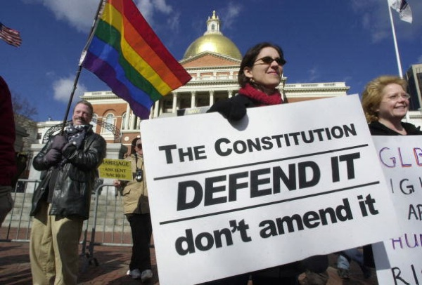 Protestors in favor of the right of gays to marry stand outside the Massachusetts State House in 2004 during Presidential Candidate Mitt Romney's term as Governor. | Photo: Michael Springer/Getty Images