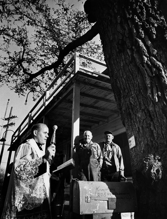 The Hangman's Oak receives a blessing in 1964. The next year, it was felled to make way for a passing Saturn V rocket. Courtesy of the Hollywood Citizen News/Valley Times Collection, Los Angeles Public Library.