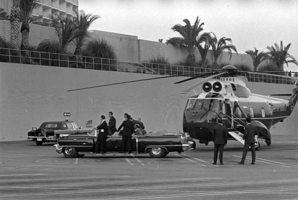 President Lyndon B. Johnson transfers from helicopter to limousine in Century City, hours before march would nearly lead to his emergency evacuation. Courtesy of the Los Angeles Times Photographic Archive, Young Research Library, UCLA.