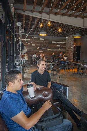 Caleb Sorola, left, and Joe DiGerolamo enjoying their coffee. | Photo: Douglas McCulloh